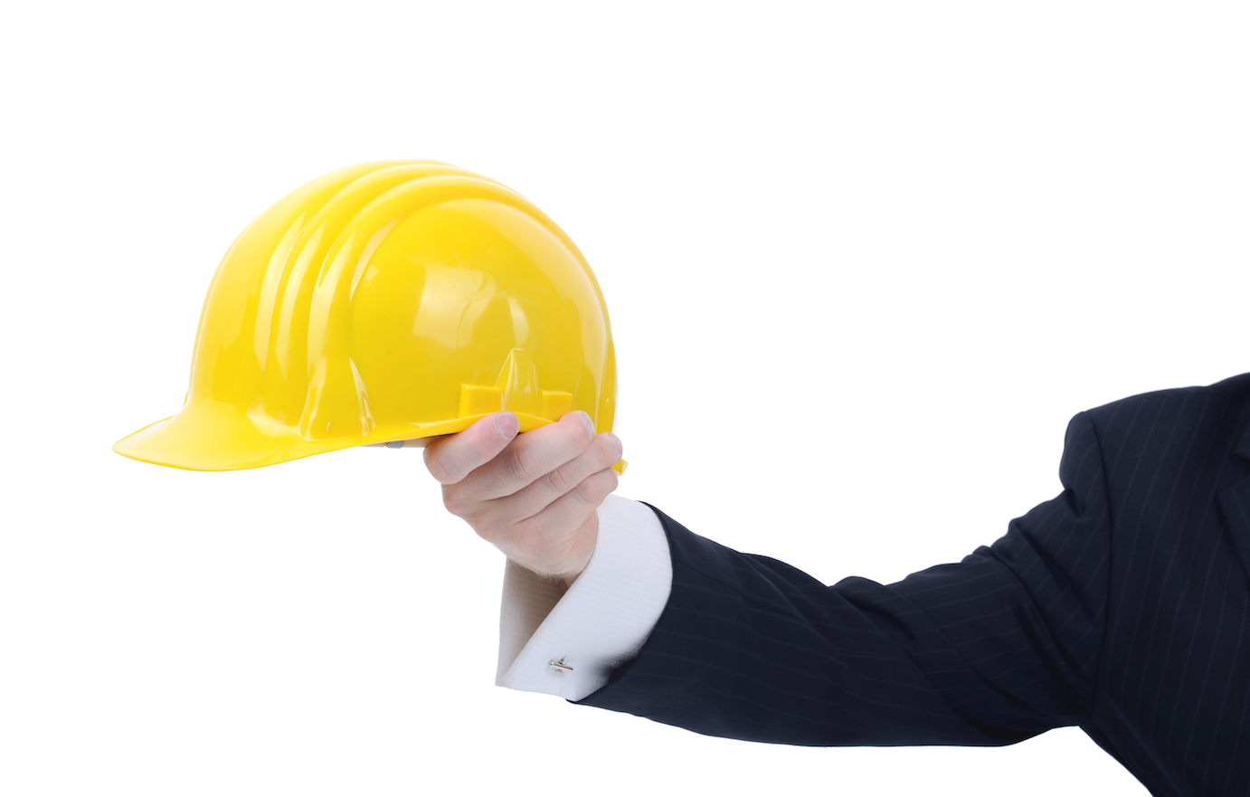 Hard Hat held by man in suit and cufflinks